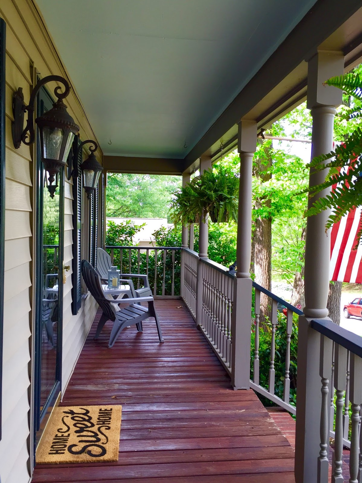 Adding a balcony to a house - Not Much Has Been Done Except For Adding Some Boston Ferns Adirondacks Tables And Lanterns