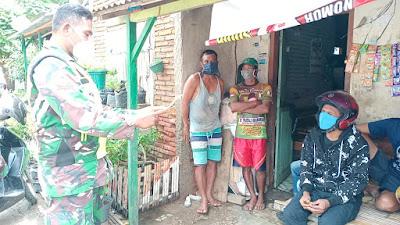 Bhabinsa tengah mengimbau warga untuk patuhi 3M