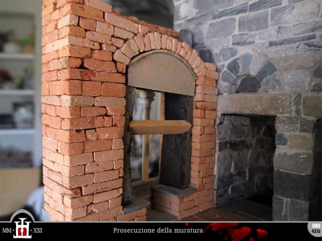 Rinfianco dell'arco e prosecuzione della muratura