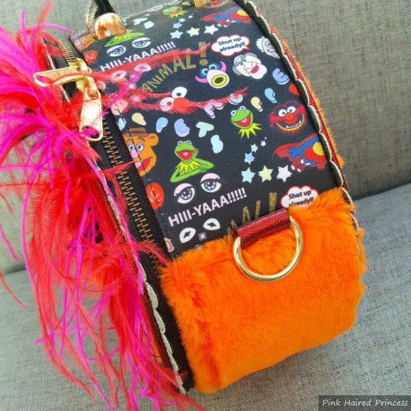 orange fur, feather and Muppets print fabric side of round bag
