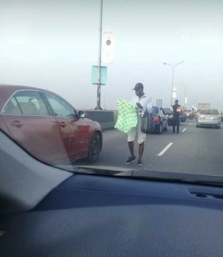 Traffic Hawker pictured selling the Nigerian jersey