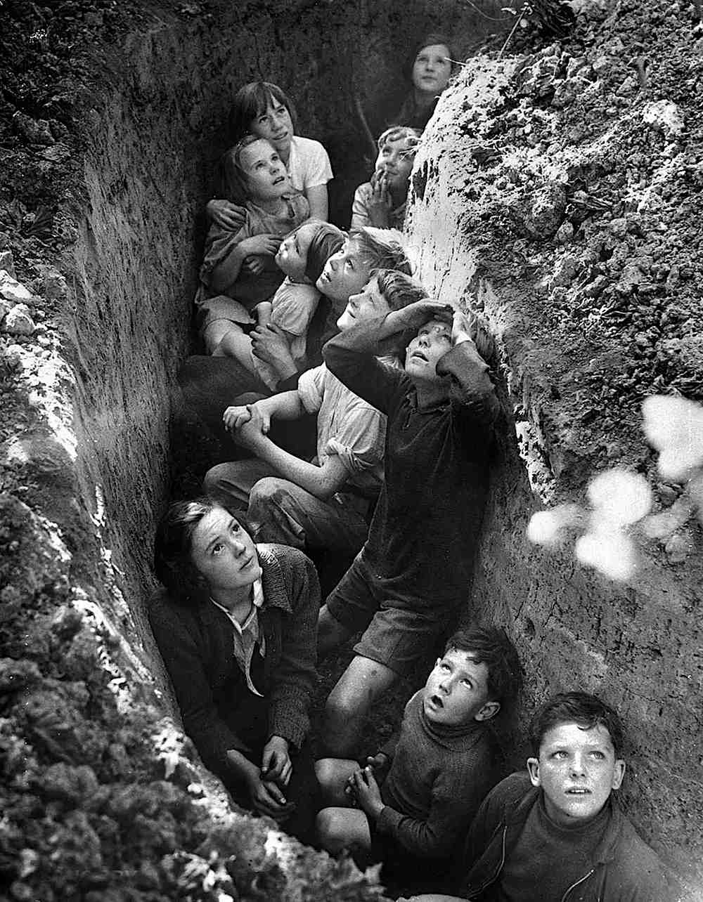children in a trench during the London Blitz, a photograph