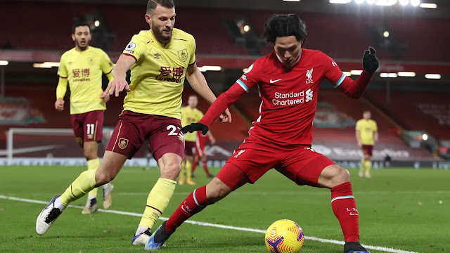 Liverpool midfielder Takuni Minamino tries to beat  Burnley defender