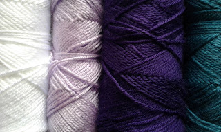 purple, lavender, white and teal yarn