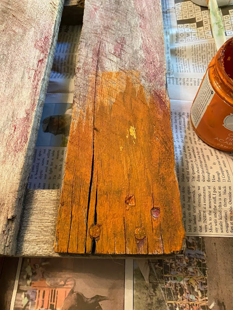 Photo of a pallet portion being painted orange