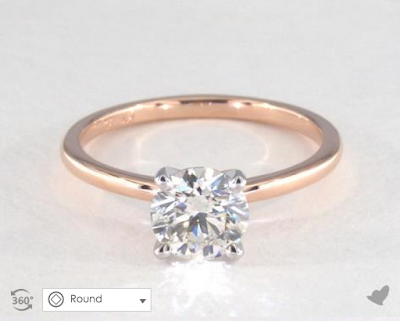 a thin rose gold band with a round diamond.