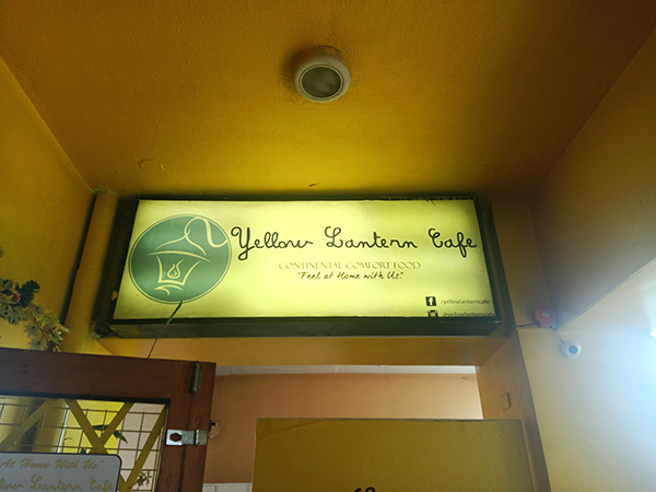 yellow lantern cafe signage