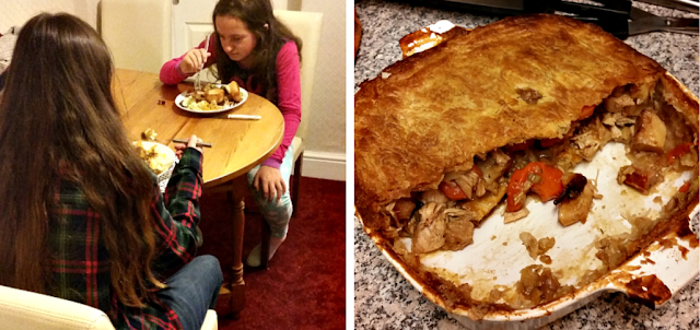 My two girls sat around the table eating their tea and half a meat and vegetable pie.