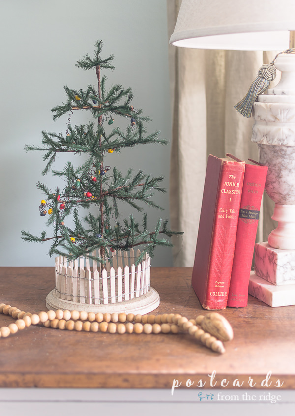 little green feather tree and vintage red books
