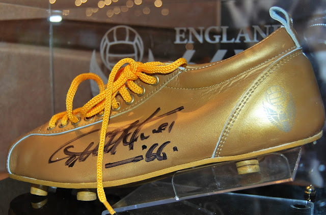Golden boot in the Bobby Moore lounge at Royal Garden Hotel, photo by Modern Bric a Brac