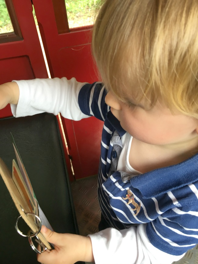 toddler-with-clipboard-and-key-attached