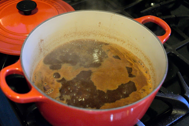 The bbq sauce simmering on the stove.