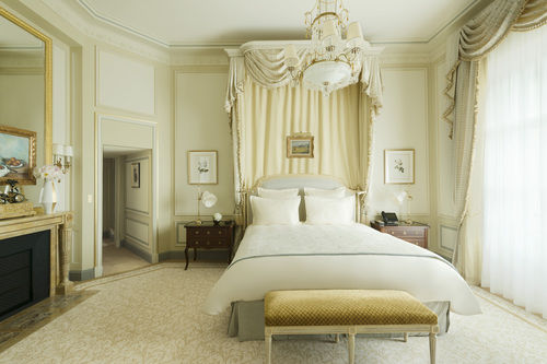 Pastels and cream guest suite with canopy bed at Ritz Paris