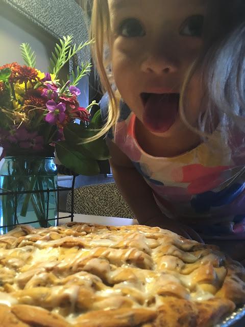 Cayenne about to eat cinnamon bun apple pie