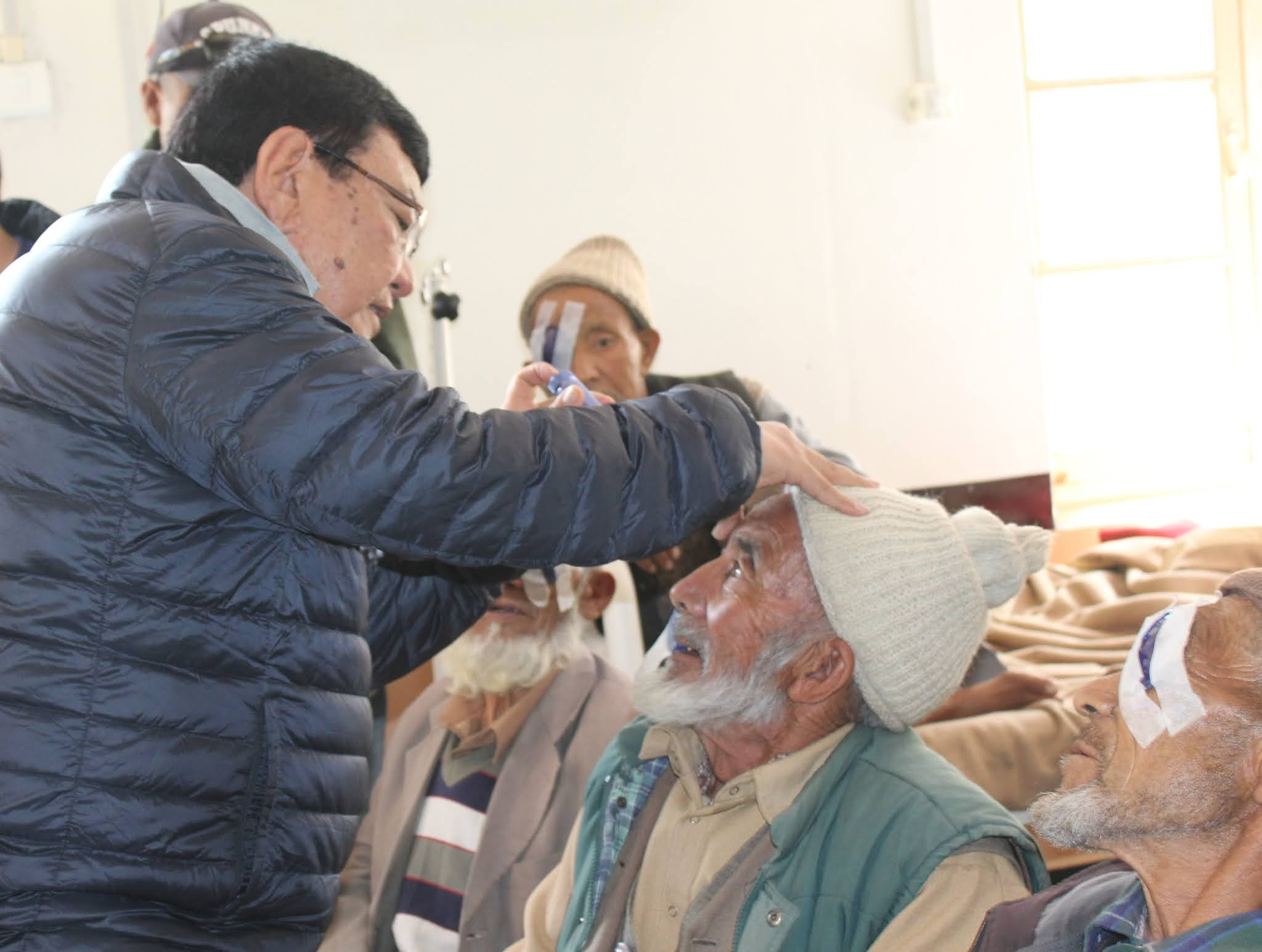 Dr sanduk ruit famous eye surgeon of nepal examining post operative patient