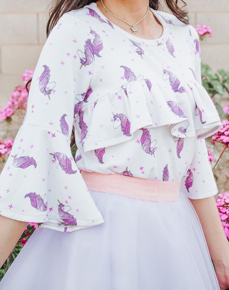 unicorn print ruffle blouse close up