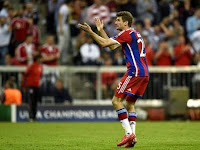 Thomas Muller scored Bayern's third to give side slim hope