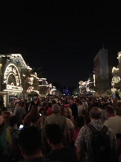 Lit up Main Street USA at night at Disneyland