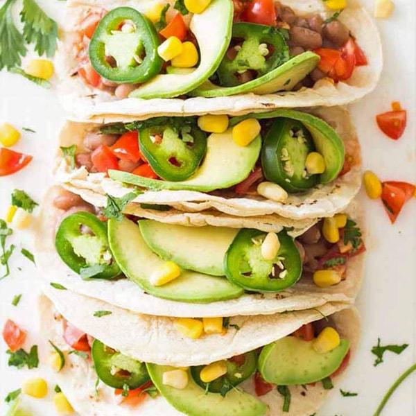 Vegan pinto beans fresh toppings delicious taco