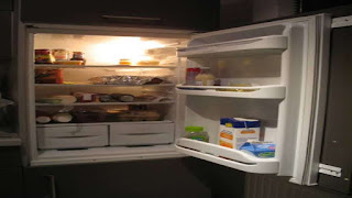 If the door of the fridge is opened by turning on the fridge in the closed room, is the room warm?