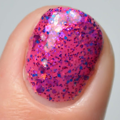 magenta glitter nail polish close up