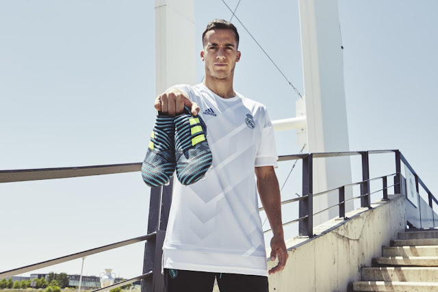 Real Madrid C.F. 's Lucas Vazquez posing with the  new Ocean Storm NEMEZIZ 17+ 360 AGILITY football boots