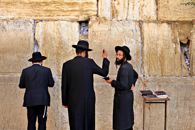 Jews praying in front of the Wailing Wall in Jerusalem