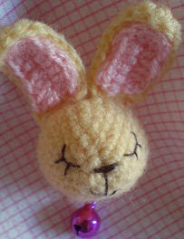 http://www.ravelry.com/patterns/library/amigurumi-bunny-brooch-pattern