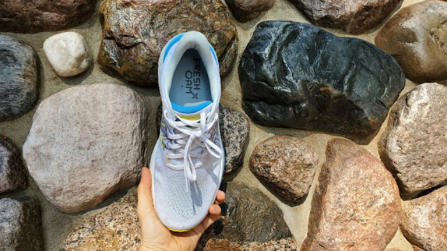 Vongo held over rocks to show upper. Well padded heel cup seen with Fresh Foam written on insole.