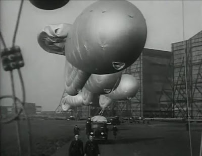 The barrage balloons leaving their hangars