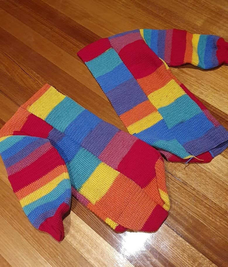 a picture of a rainbow-colored crocheted jumper
