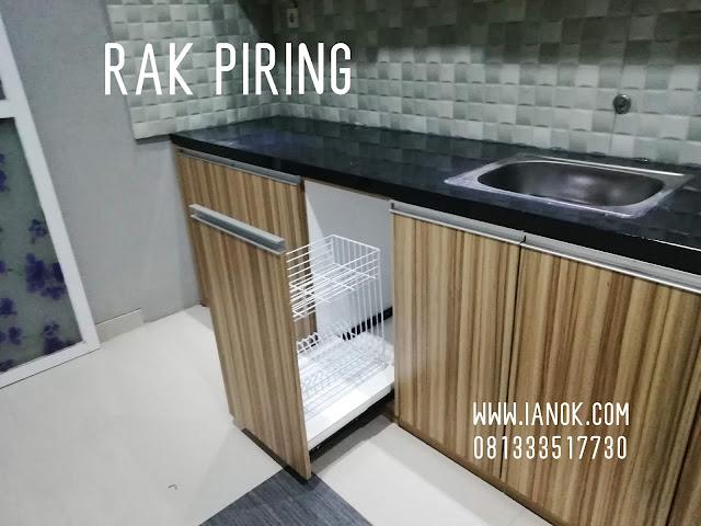 rak piring didalam kitchen set gresik