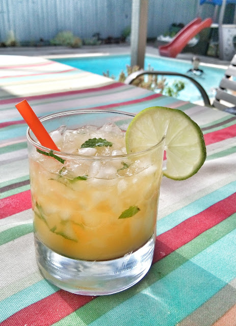 faux mojito with lime, mint, strawberries, and lemon