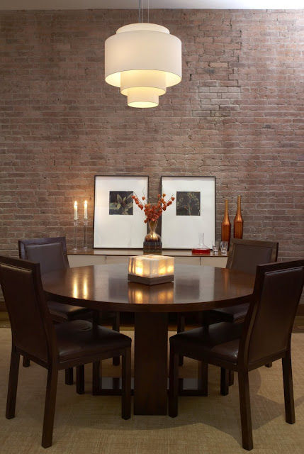 dining room with stone wall