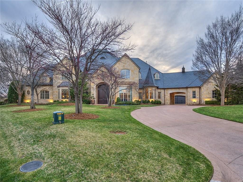 This stone mansion in oklahoma city ok was built in 2002 and situated on just under an acre of land on a cul de sac boasting panoramic views of the
