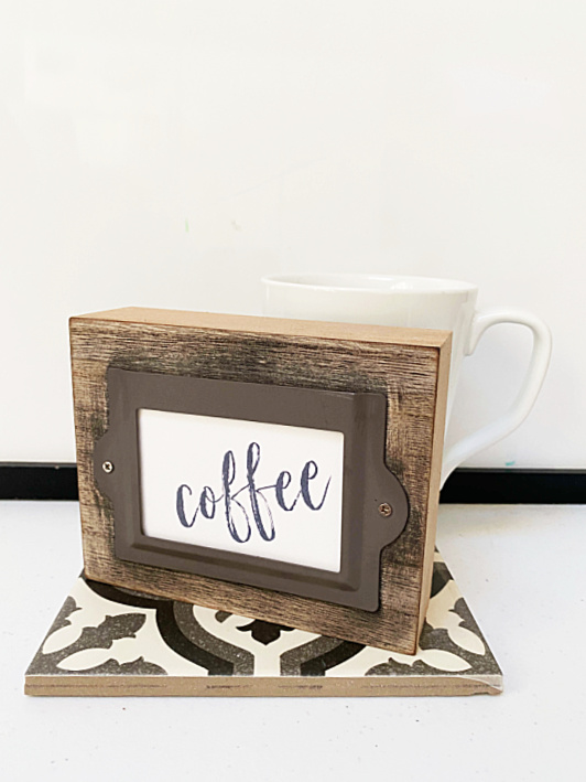 dollar store coffee sign with a tile and mug