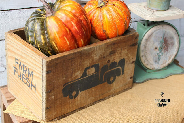 A crate stenciled with a fall truck