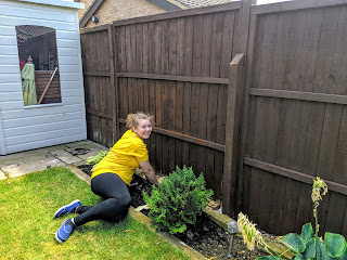 Top Ender painting a fence as an act of service