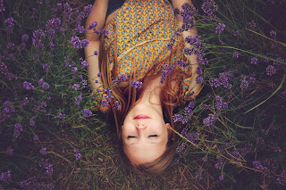 Photo of woman with closed eyes by Amy Treasure on Unsplash