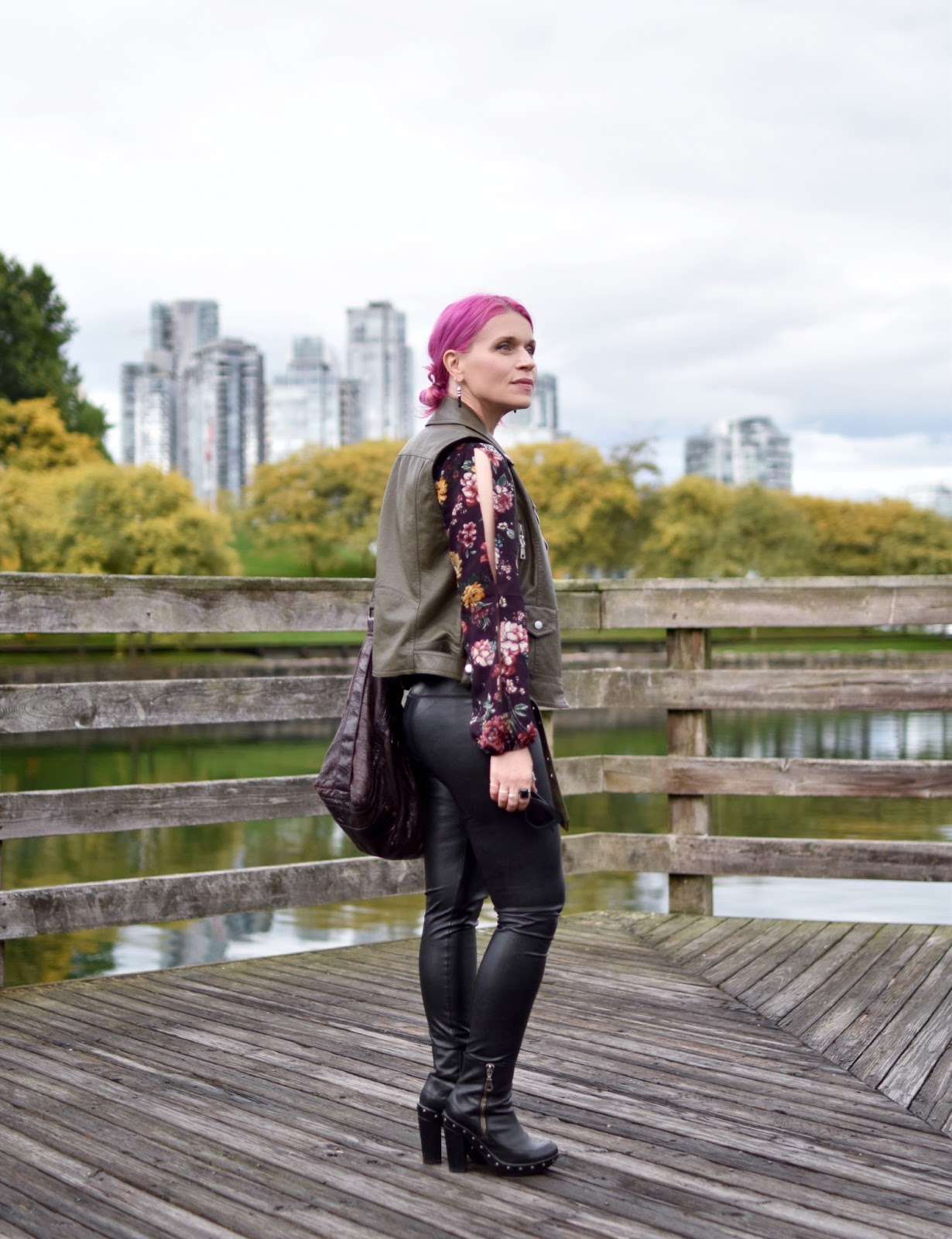 Monika Faulkner outfit inspiration - split-sleeve floral blouse, vegan leather leggings, moto vest, platform booties