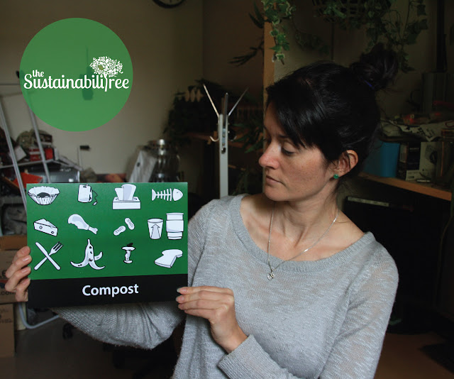 Our waste diversion coordinator at the University of Ottawa holds up a new compost sign