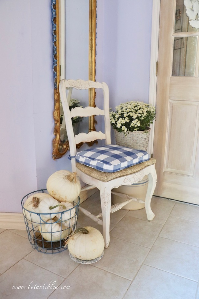 Fall blue and white cottage style small foyer includes medium blue accents in five places