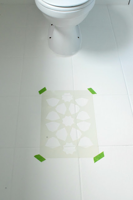 how to stencil a tile floor with chalk paint to get the look of Moroccan tile