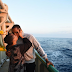 Photo of a Nigerian migrant couple kissing aboard a ship after being rescued in the Mediterranean