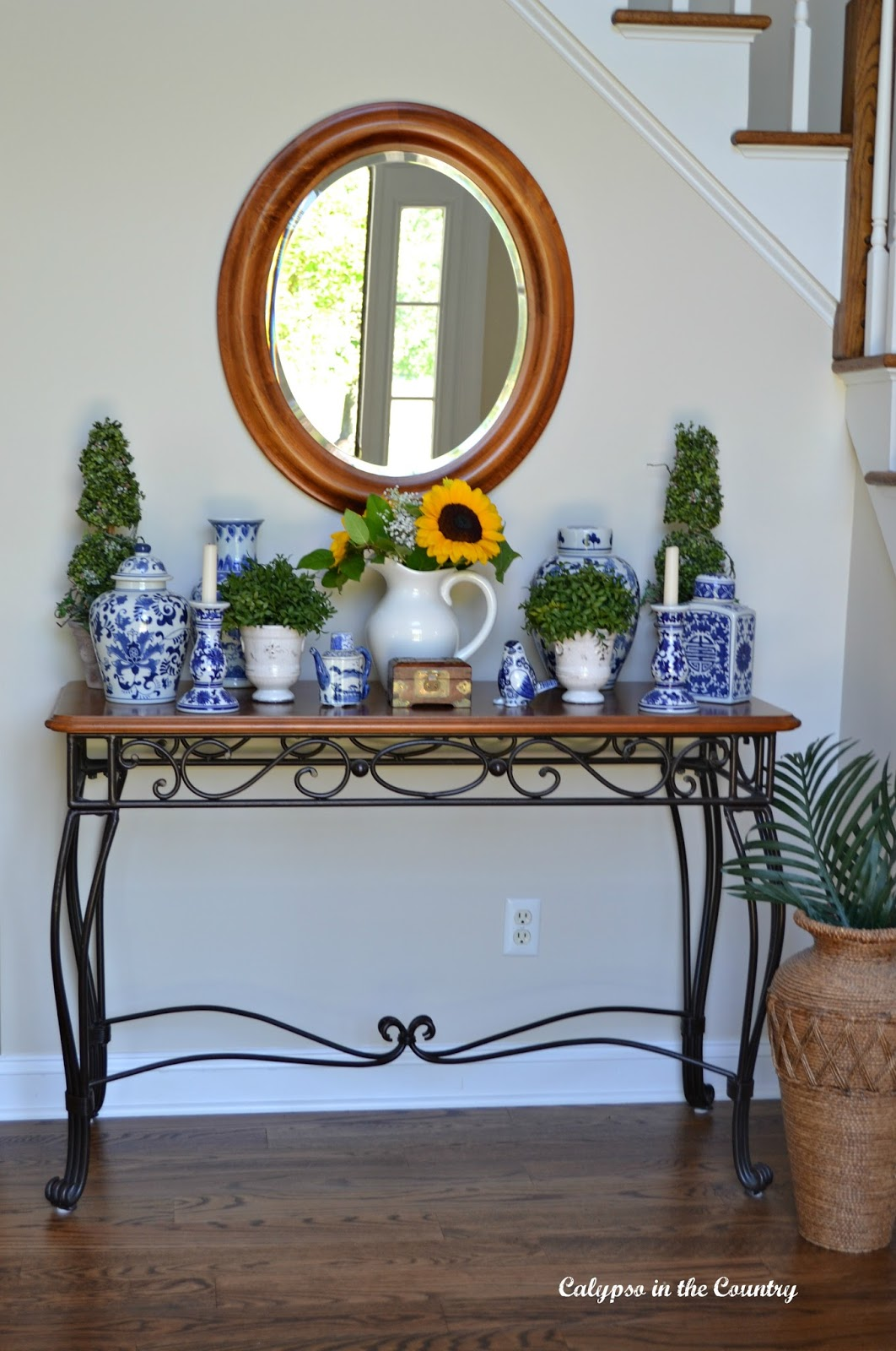 Oval Foyer Mirror : Blue and white with sunflowers in the foyer calypso