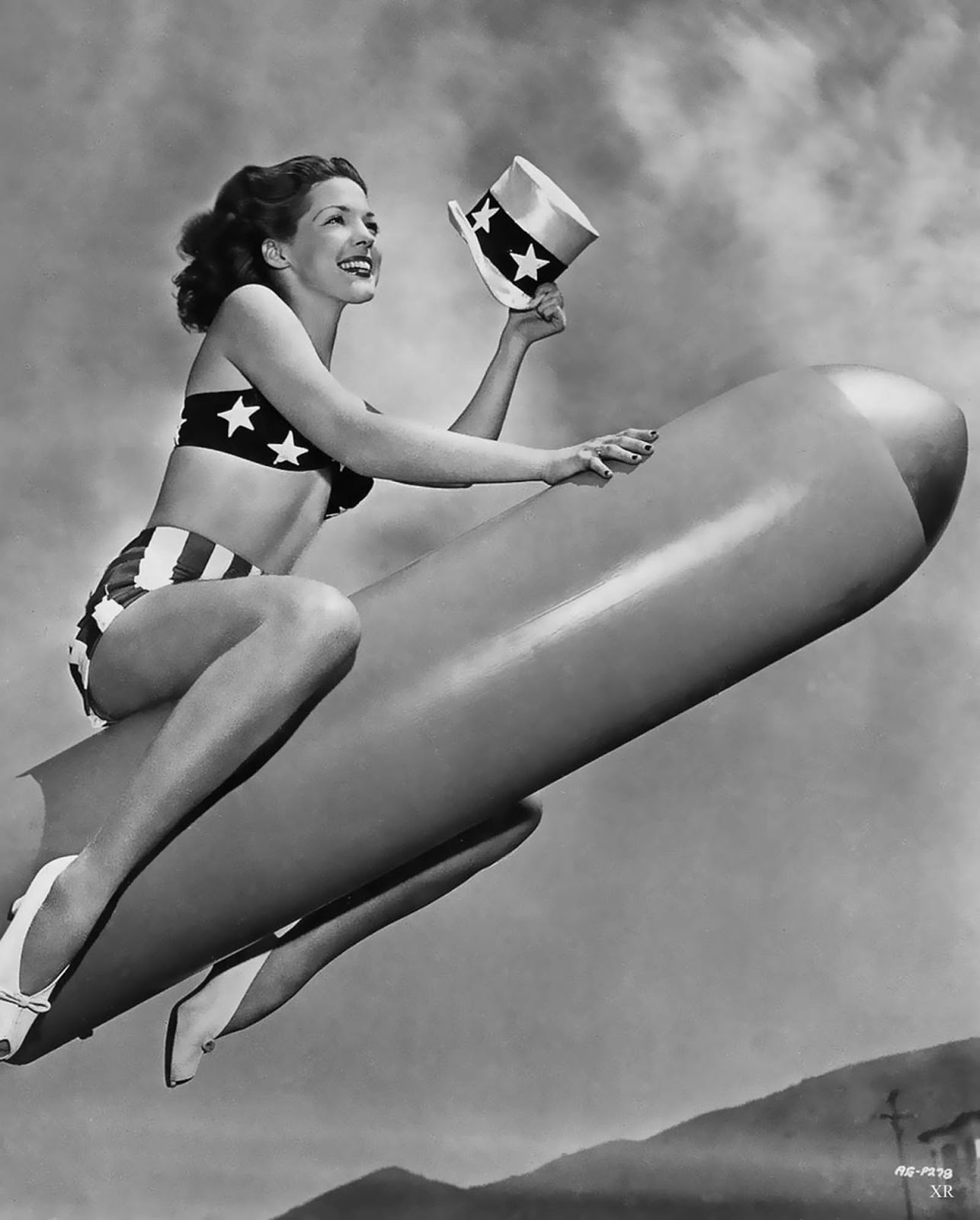 We don't know why this shot was taken, and why this pretty girl is riding a torpedo. However, it's from 1944 and, well... we like it.