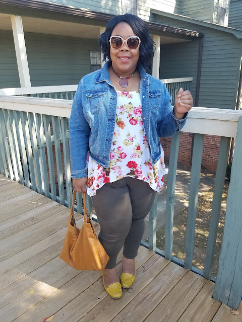 plus sized blogger in blush sunglasses, denim jacket, floral blouse, olive skinny jeans and mustard loafers