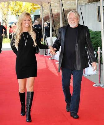 Juanita Dorricott walking holding the hand of her husband Bob