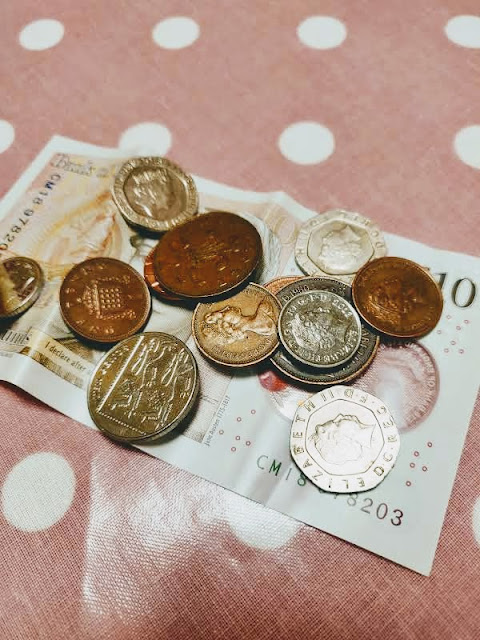 Sterling cash on tablecloth