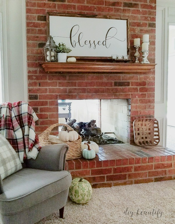 dirty and dated 80's brick fireplace | diybeautify.com